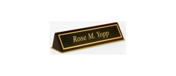 Polished brass name plates with an attractive piano polished wood display base.