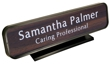 Laser engraved name plates in a variety of color options with attractive, framed display stand.