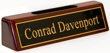 Polished brass name plates with an attractive piano polished wood display base with slot for business cards.