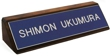 Laser engraved name plates or full color name plates with an attractive walnut wood display base.
