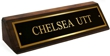 Polished brass name plates with an attractive walnut wood display base.